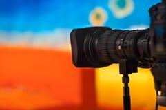 Television studio. Video camera lens - recording show in TV studio - focus on camera Stock Photos