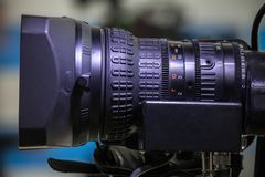 Television studio camera lens. Television Video camera lens - recording show in TV studio - focus on camera aperture Royalty Free Stock Photography