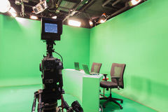 Television studio. With camera and lights - camera on tripod Royalty Free Stock Image