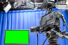 Television studio. With camera and lights - camera on tripod Royalty Free Stock Photos