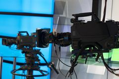 Television studio with camera and lights - recording TV show. Shallow depth of field stock photography