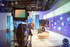 Television studio with camera and lights - recording TV show stock photo