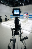 Television studio with camera and lights Royalty Free Stock Photos