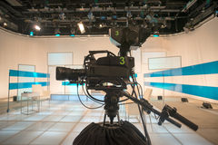 Television studio with camera and lights Stock Image