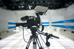 Television studio with camera and lights Royalty Free Stock Image