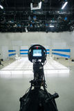 Television studio with camera and lights Royalty Free Stock Photo