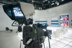 Television studio with camera and lights Royalty Free Stock Images