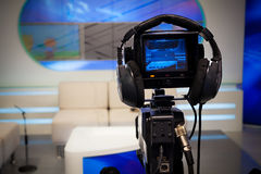Television studio camera. Video camera lens - recording show in TV studio - focus on camera Royalty Free Stock Images