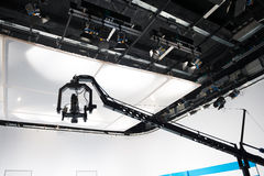 Television studio with jib camera and lights Stock Images