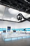 Television studio with jib camera and lights Royalty Free Stock Photography