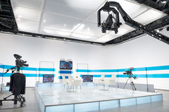 Television studio with jib camera and lights Royalty Free Stock Images