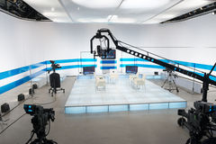 Television studio with jib camera and lights Stock Photography