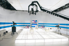 Television studio with jib camera and lights Royalty Free Stock Photos