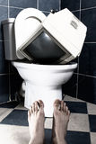 Television in toilet Stock Photos