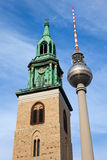 Television tower in Berlin beside a church Royalty Free Stock Images