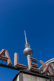 Television tower (Fernsehturm) and ALEX letters. The letters ALEX of the station Berlin-Alexanderplatz with the famous tv tower (Fernsehturm) in the background Stock Image