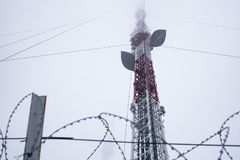 Television tower in the fog on a background cloudy sky Stock Photos
