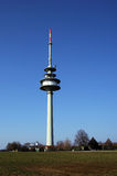 Television tower in Germany. Surrounded by small houses Stock Photo