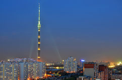 Television tower. Lit by lamps television tower in the evening on the background of houses Stock Images