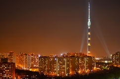 Television tower. Lit by lamps television tower in the night on the background of houses Royalty Free Stock Image