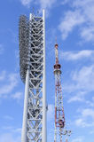 Television tower and tower with floodlights Royalty Free Stock Photo