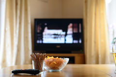 Television, TV watching (movie) with snacks lying on table Stock Photo