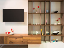 Television on wall an wooden timber shelf units Royalty Free Stock Photo