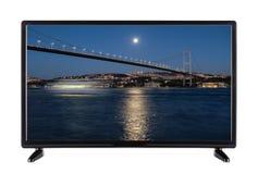 Televisione a alta definizione con la città di notte e il illuminat del ponte Fotografia Stock