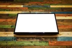 Televisione in bianco dello schermo piano dell'affissione a cristalli liquidi che appende al wa di legno delle plance Immagine Stock