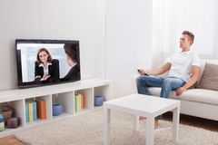 Televisione di sorveglianza del giovane Fotografia Stock