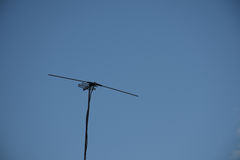Televisions antennas with clear sky background. Royalty Free Stock Photography