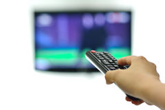 Televison remote control changes channel Royalty Free Stock Images