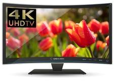 Televisor de alta definición ultra curvado de 4K UHD en el fondo blanco Fotografía de archivo libre de regalías