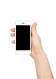 Teléfono celular móvil a disposición con la pantalla negra en blanco Imagen de archivo