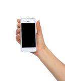 Teléfono celular móvil a disposición con la pantalla negra en blanco para la copia del texto Imágenes de archivo libres de regalías