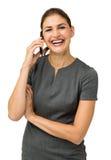 Teléfono de Laughing While Using Smart de la empresaria Imágenes de archivo libres de regalías