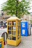 Teléfono del amarillo de Luxemburgo de los posts Imagen de archivo libre de regalías