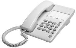 Teléfono del blanco de la oficina Imágenes de archivo libres de regalías