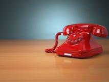 Teléfono del vintage en fondo verde Concepto de la ayuda de la línea directa Fotos de archivo