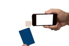Teléfono móvil con el lector Isolated On White de la tarjeta de crédito Imagen de archivo