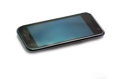 Teléfono móvil con la pantalla táctil Imágenes de archivo libres de regalías