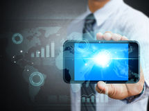 Teléfono móvil de la tecnología moderna en una mano Foto de archivo libre de regalías