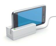Teléfono móvil en el lector de tarjetas Imágenes de archivo libres de regalías