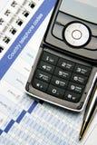 Teléfono móvil en organizador Imagen de archivo