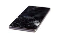 Teléfono móvil quebrado aislado en blanco Imagen de archivo