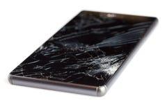 Teléfono móvil quebrado aislado en el fondo blanco Fotos de archivo libres de regalías