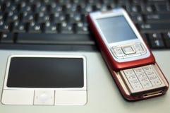 Teléfono móvil rojo del resbalador Fotos de archivo libres de regalías