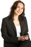 Teléfono móvil sonriente del asimiento de la mujer Imagen de archivo