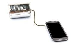 Teléfono y Tin Can Telephone elegantes I Foto de archivo libre de regalías