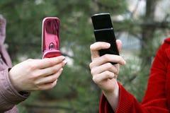 Teléfonos en manos Fotografía de archivo libre de regalías